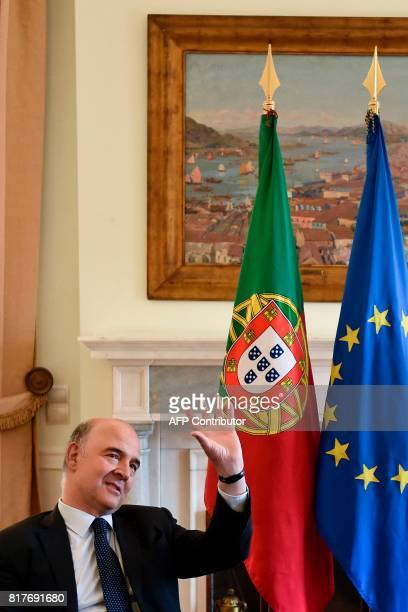 European Economic and Financial Affairs Commissioner Pierre Moscovici gestures during his meeting with the Portuguese Prime Minister at Sao Bento...