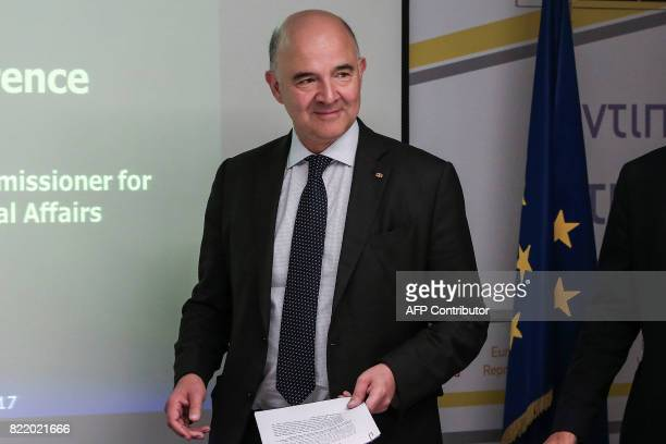 European Economic and Financial Affairs Commissioner Pierre Moscovici arrives for a news conference at the EU Commission Representation offices in...