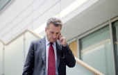 European Energy Commissioner Guenther Oettinger arrives for a party board meeting of German Christian Democrats in CDU headquarters...