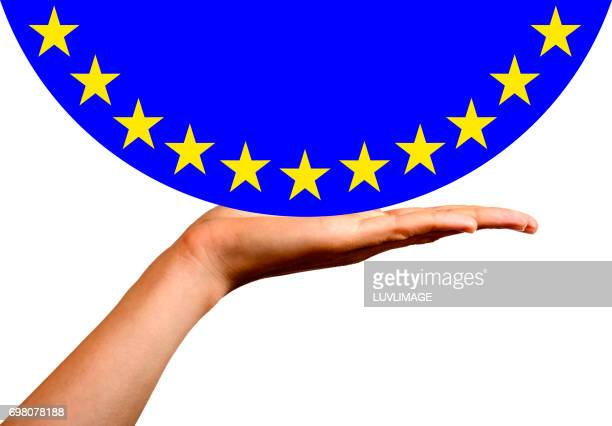European Flag in a hemisphere, on an open hand.