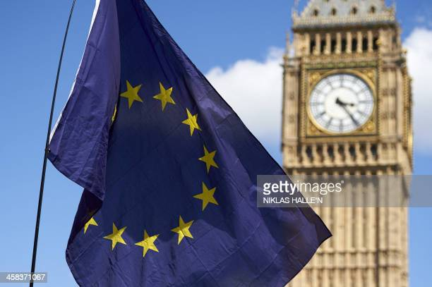 A European flag is flown in front of The Elizabeth Tower which houses the 'Big Ben' bell in the Palace of Westminster as thousands of protesters...