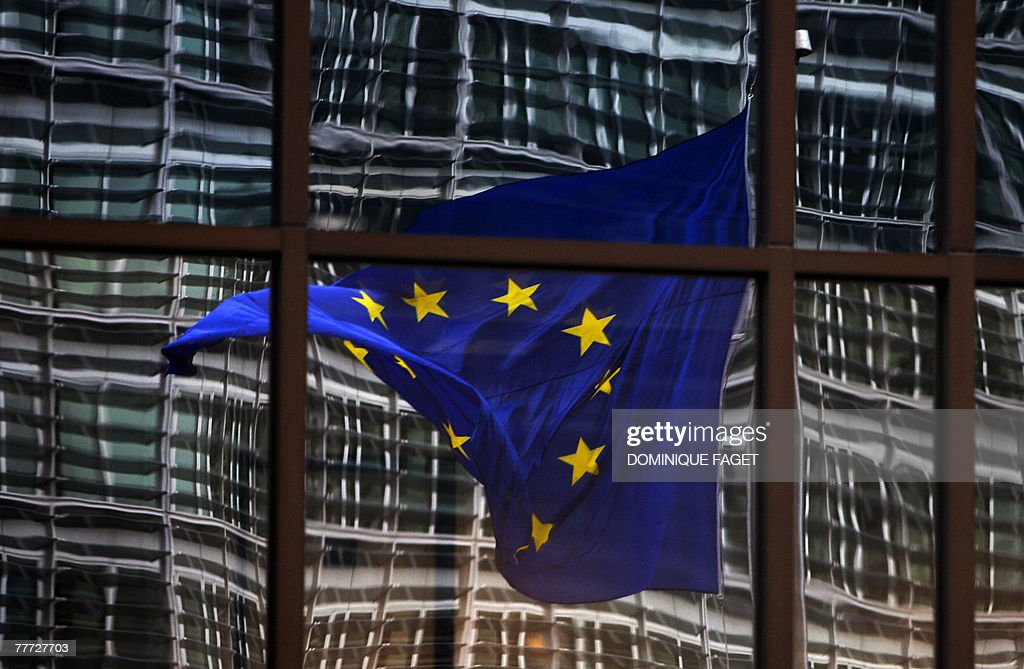 A European flag reflects 06 November 2007 in a building of the EU headquarters in Brussels.
