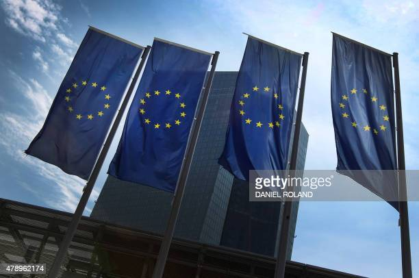 European flags are on display in front of the headquarters of the European Central Bank in Frankfurt am Main western Germany on June 29 2015 After...