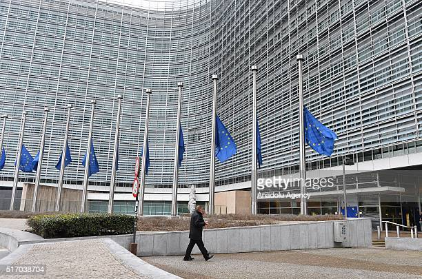 European flags fly at half mast in front of the EU Berlaymont building in the centre of Brussels following multiple blasts in Brussels Belgium on...