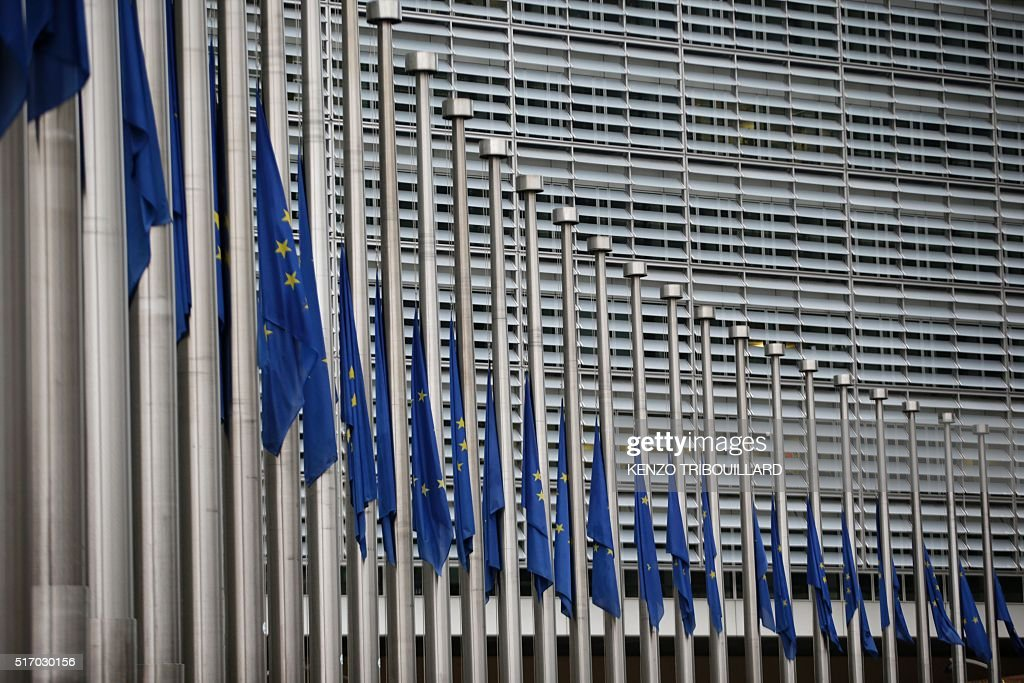 TOPSHOT European flags fly at half mast in front of the headquarters of the European Commission in Brussels on March 23 a day after triple bomb...