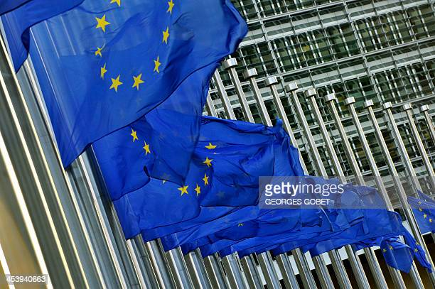 European flags fly at halfmast as a tribute to late South African antiapartheid icon Nelson Mandela at the Berlaymont European Union Commission...