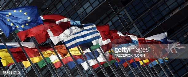 European flags with the British Union Jack flag fly in front of the European Parliament on June 9 2016 in Strasbourg eastern France On June 23 2016...