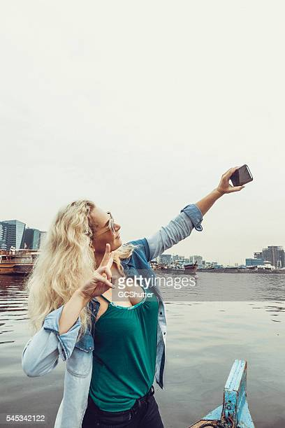 European Girl Taking Selfie From a Boat in Dubai