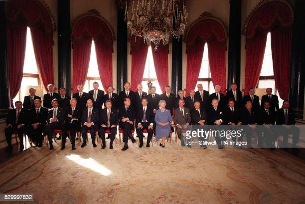 European heads of state gather for a formal photograph with the Queen and the Duke of Edinburgh in the White Drawing Room at Buckingham Palace today...