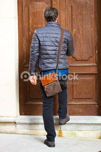 European Man With Bag Arriving Home Stock Photo
