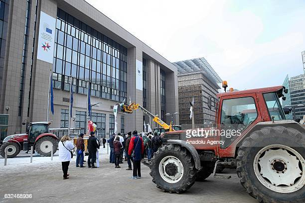 European Milk Board representatives spray milk powder in front of the European Council during a meeting of EU ministers of agriculture in Brussels on...