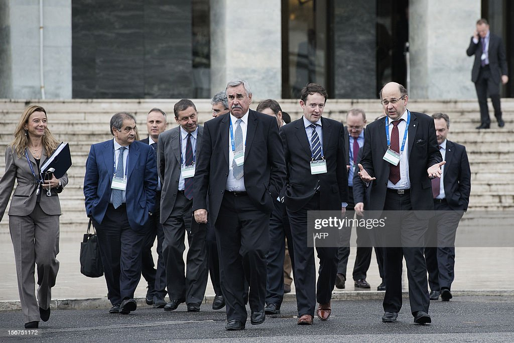 European ministers and researchers walk to the Mostra d'Oltremare Congress center to attend the European Space Agency (ESA) Council Meeting on November 20, 2012 in Naples.
