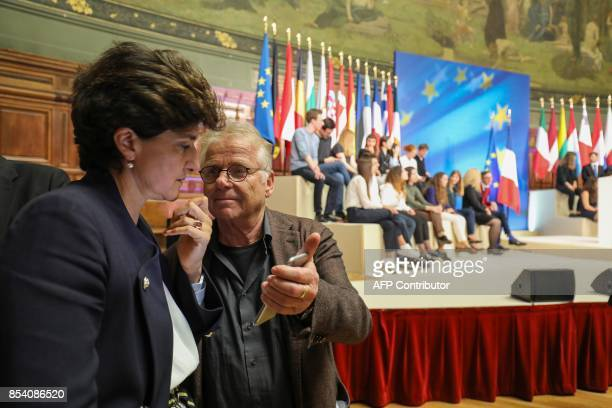European MP Daniel CohnBendit shows his mobile phone to former French Defence Minister Sylvie Goulard prior to the start of the French President's...