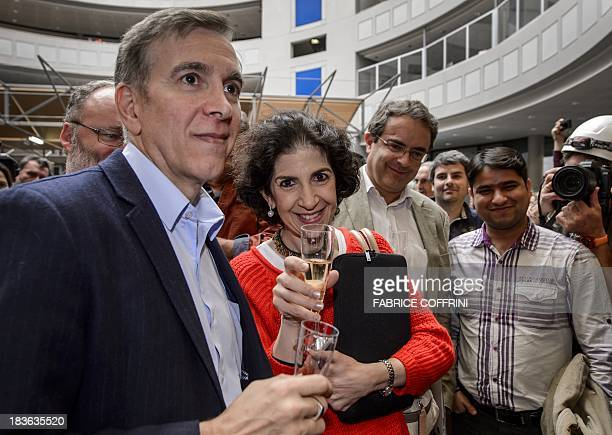 European Organisation for Nuclear Research scientists CMS experiment spokesperson Joe Incandela ATLAS's Fabiola Gianotti celebrate with champagne...