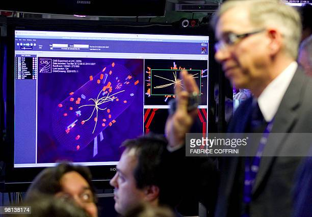 European Organization for Nuclear Research scientists reacts after the first ultra highenergy collisions at the CMS experiment control room on March...