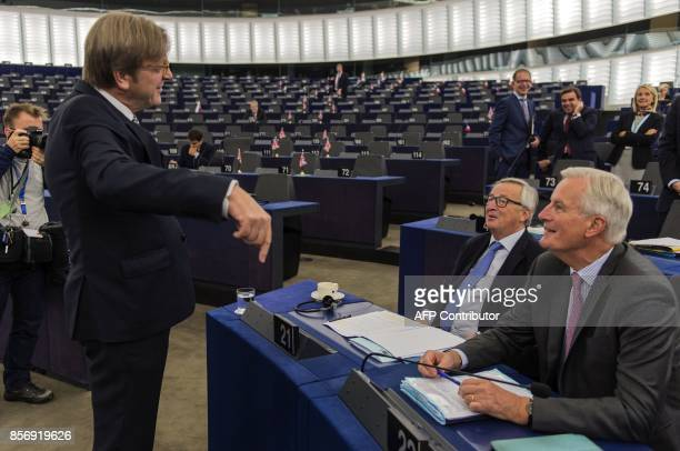 European Parliament Brexit chief Guy Verhofstadt talks with European Commission President JeanClaude Juncker and European Chief Negotiator for Brexit...