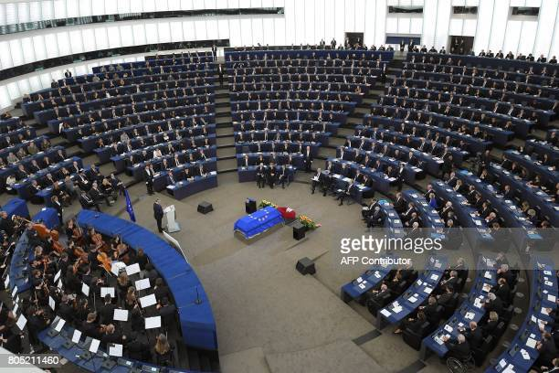 European Parliament president Antonio Tajani delivers a speech in fronf of former US President Bill Clinton German Chancellor Angela Merkel French...