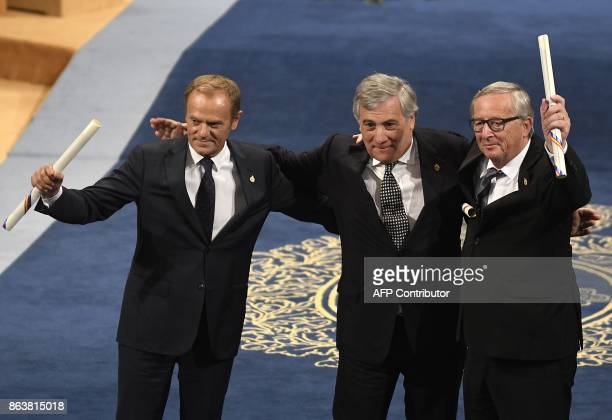 European Parliament president Antonio Tajani European Council president Donald Tusk and European Commission president JeanClaude Juncker acknowledge...