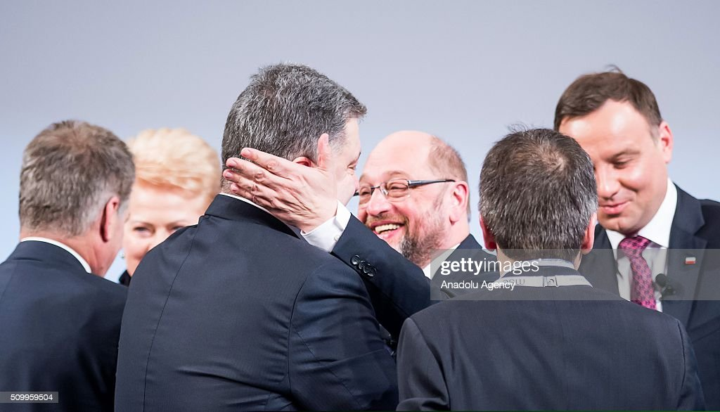 European Parliament President Martin Schultz (C) greets Ukrainian President Petro Poroshenko (front C) during the 2016 Munich Security Conference at the Bayerischer Hof hotel on February 13, 2016 in Munich, Germany. The annual event brings together government representatives and security experts from across the globe and this year the conflict in Syria will be the main issue