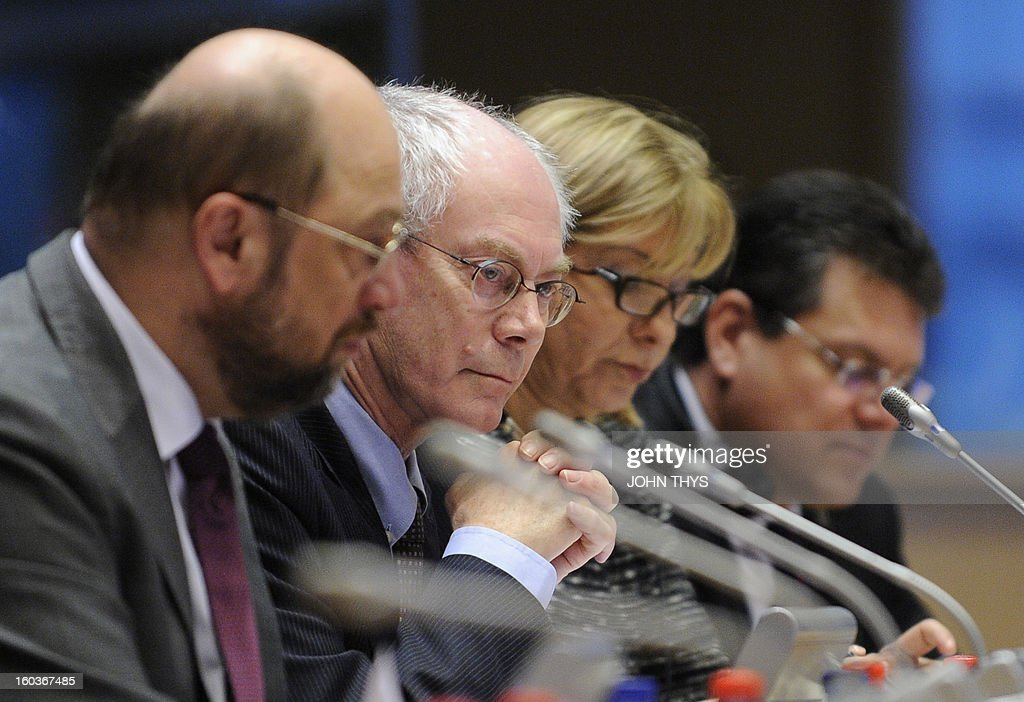 European Parliament President Martin Schulz (L) and European Union President Belgian Herman Van Rompuy (C) attend the 'European Parliamentary Week on the European Semester' on economic policy coordination at the European Parliamen in Brussels on January 30, 2013.