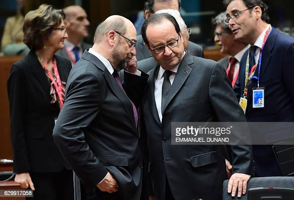 European Parliament President Martin Schulz and French President Francois Hollande speak together ahead of a European Union leaders summit at the...