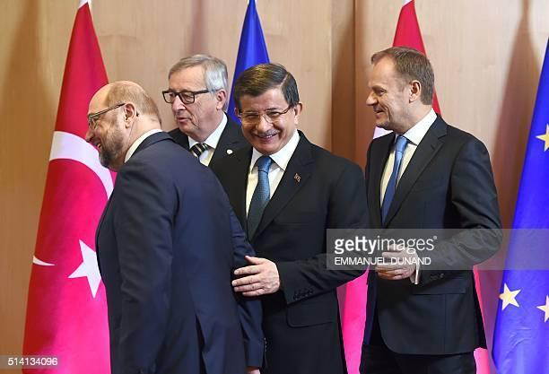 European Parliament President Martin Schulz European Commission President JeanClaude Juncker Turkey's Prime Minister Ahmet Davutoglu and European...