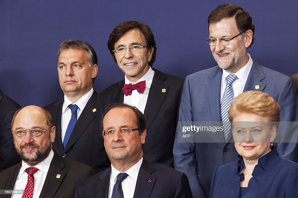 European Parliament President Martin Schulz, French President Francois Hollande, Lithuanian President Dalia Grybauskaite, Hungarian Prime Minister Viktor Orban, Belgian Prime Minister Elio Di Rupo and Spanish Prime Minister Mariano Rajoy pose on October 24, 2013 for a family photo during a European Council meeting at the EU headquarters in Brussels. European Union leaders opened on October 24 a summit dominated by a row over American spying that targeted German Chancellor Angela Merkel.