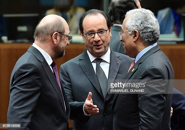 European Parliament President Martin Schulz French President Francois Hollande and Portuguese Prime Minister Antonio Costa speak toghether ahead of a...
