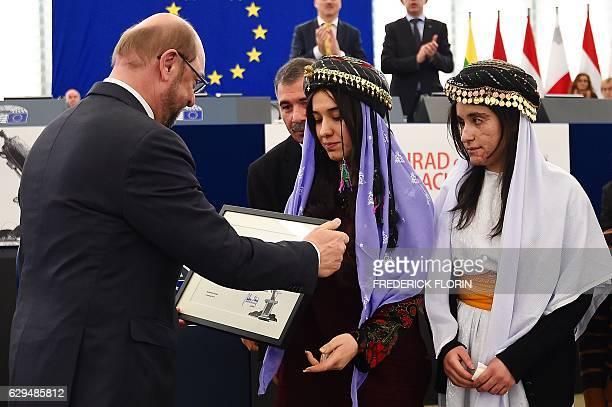 European Parliament President Martin Schulz gives to Nadia Murad and Lamia Haji Bashar public advocates for the Yazidi community in Iraq and...