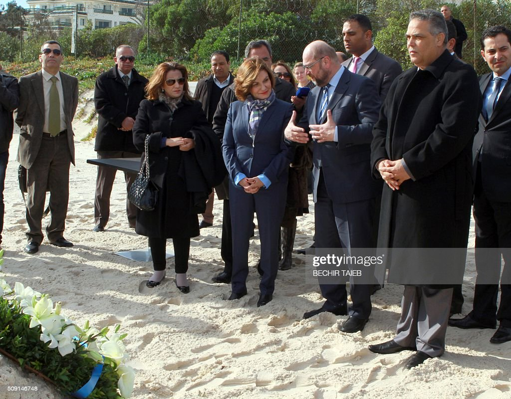 European parliament president Martin Schulz (2ndR), Imperial Marhaba Riu hotel manager Zohra Driss (3rdR) and Sousse governor Fethi Bdira (R) lay flowers on February 9, 2016, in Port el Kantaoui, on the outskirts of Sousse, south of the capital Tunis, in memory of the 38 victims of the country's worst-ever jihadist attack. / AFP / BECHIR TAIEB