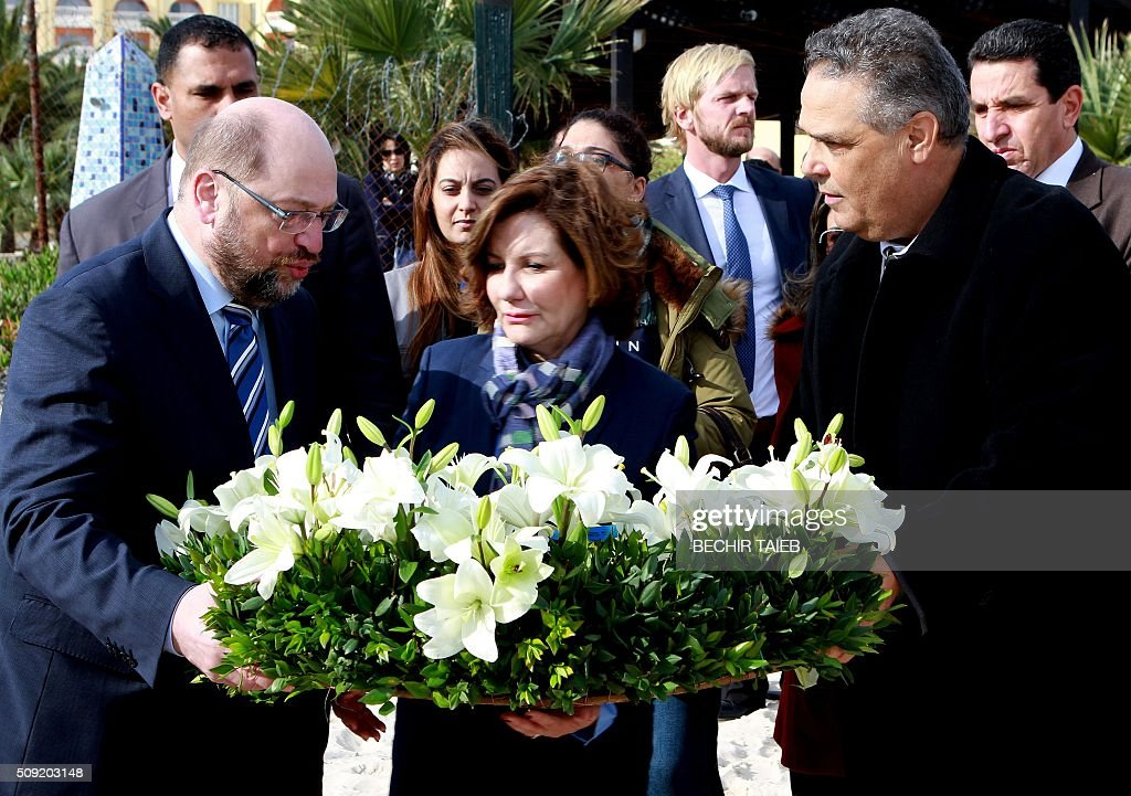 European parliament president Martin Schulz (C), Imperial Marhaba Riu hotel manager Zohra Driss (2ndL) and Sousse governor Fethi Bdira (R) lay flowers on February 9, 2016, in Port el Kantaoui, on the outskirts of Sousse, south of the capital Tunis, in memory of the 38 victims of the country's worst-ever jihadist attack. / AFP / BECHIR TAIEB
