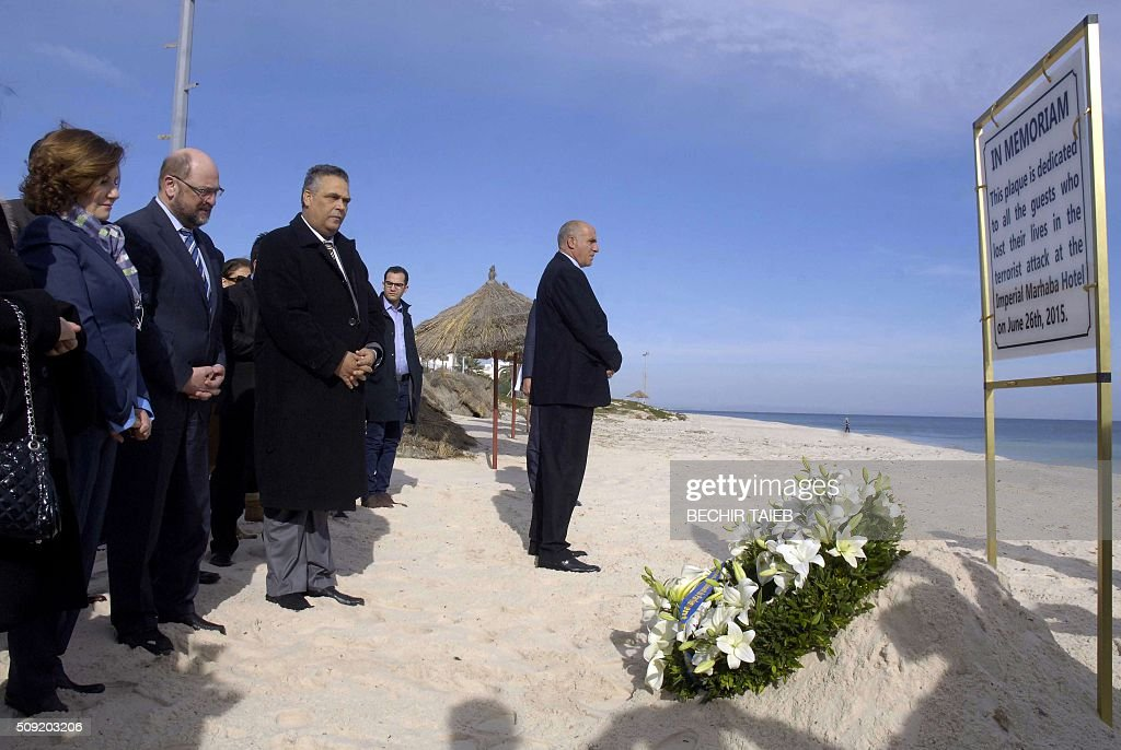 European parliament president Martin Schulz (2ndL), Imperial Marhaba Riu hotel manager Zohra Driss (L) and Sousse governor Fethi Bdira (3rdL) lay flowers on February 9, 2016, in Port el Kantaoui, on the outskirts of Sousse, south of the capital Tunis, in memory of the 38 victims of the country's worst-ever jihadist attack. / AFP / BECHIR TAIEB