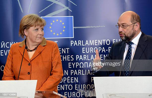 European Parliament President Martin Schulz talks to the media during a joint press conference with German Chancellor Angela Merkel following their...