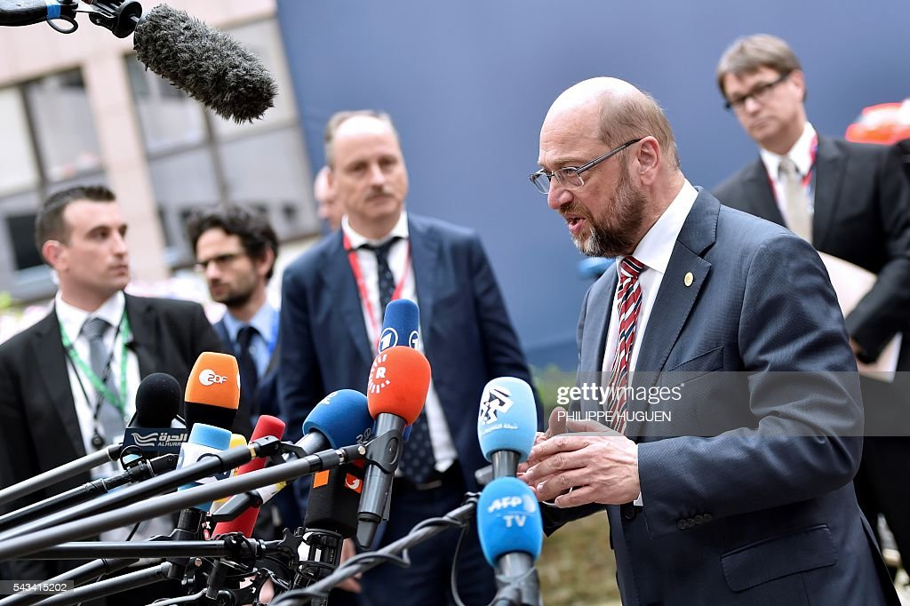 European Parliament President Martin Schulz talks to the press as he arrives before an EU summit meeting on June 28, 2016 at the European Union headquarters in Brussels. / AFP / PHILIPPE