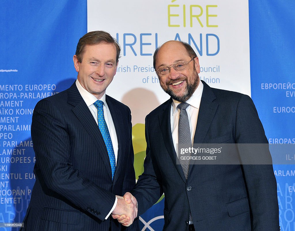 European Parliament President Martin Schulz (R) welcomes Irish Prime Minister Enda Kenny (L) on January 16, 2013 at the European Parliament in Strasbourg. Kenny told top EU officials that resolving the bank debt issue was a priority for the country's six-month EU presidency which runs to June.