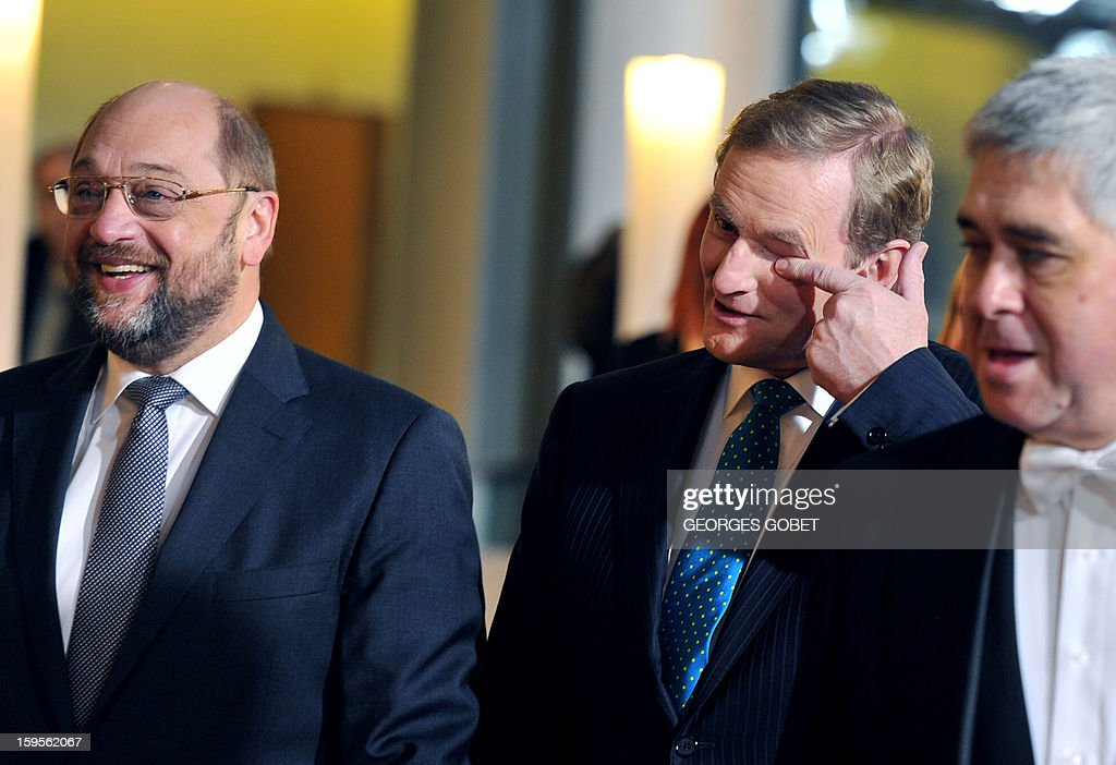 European Parliament President Martin Schulz (L) welcomes Irish Prime Minister Enda Kenny on January 16, 2013 at the European Parliament in Strasbourg. Kenny told top EU officials that resolving the bank debt issue was a priority for the country's six-month EU presidency which runs to June.