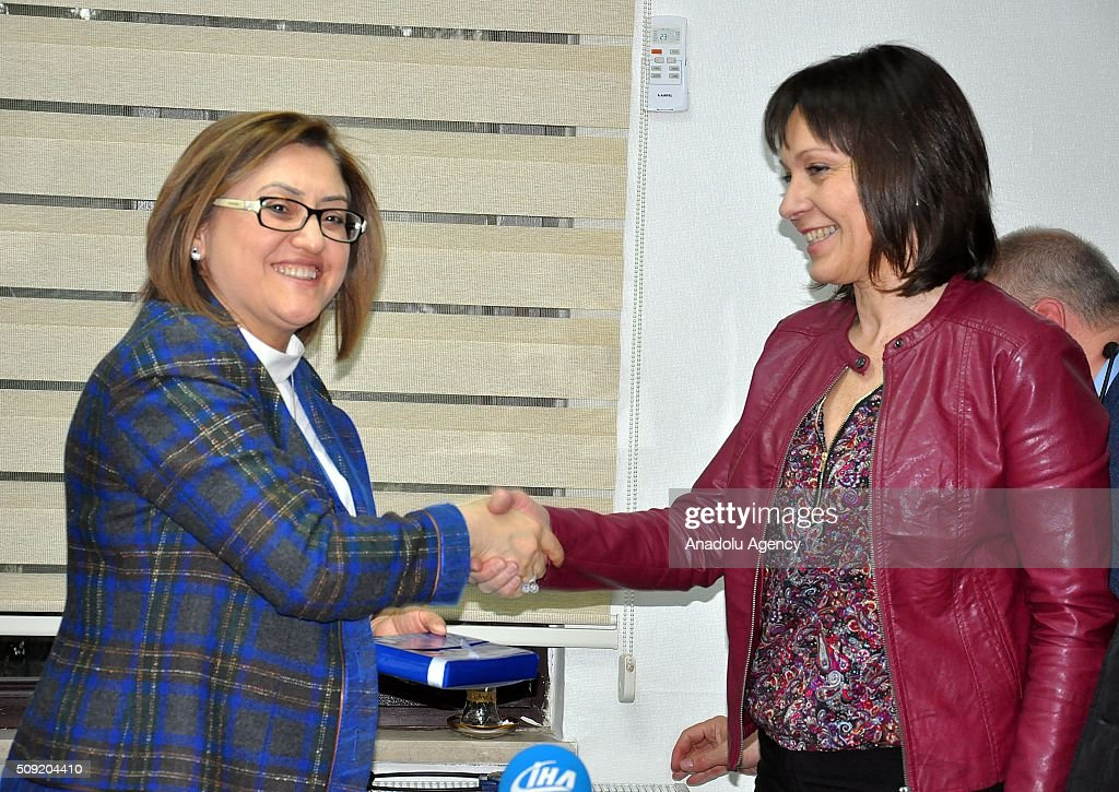 European Parliament Vice President Sylvie Guillaume (R) and Gaziantep's Mayor Fatma Sahin (L) shake hands during a meeting in Gaziantep, Turkey on February 9, 2016.