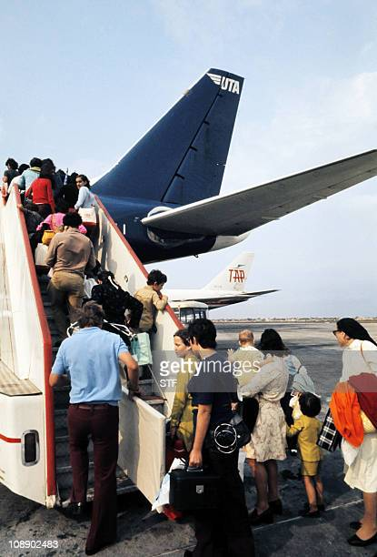European refugees and expatriates embark a plane for their evacuation to Lisbon on September 05 1975 at Luanda airport After independence Angola was...