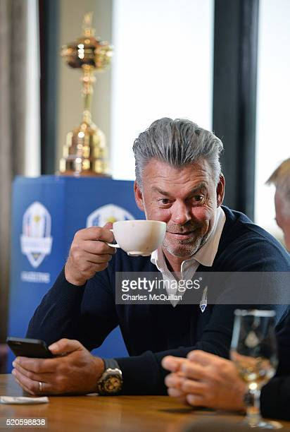 European Ryder Cup captain Darren Clarke enjoys a cup of tea as he holds a press conference at Royal Portrush golf club as part of the Ryder Cup...