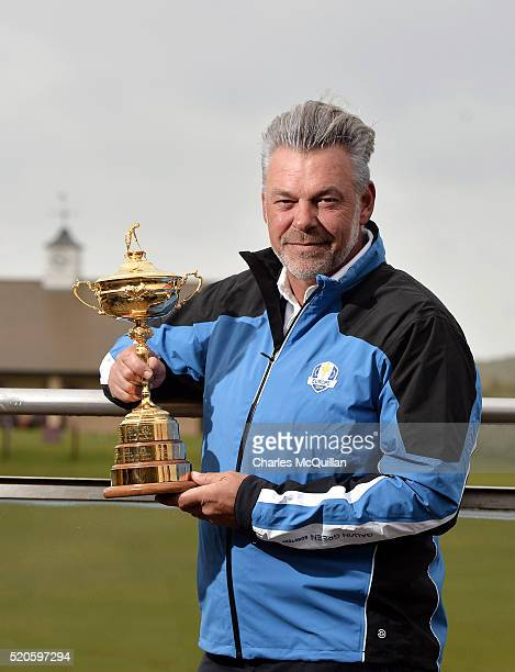 European Ryder Cup captain Darren Clarke poses with the trophy at Royal Portrush golf club as part of the Ryder Cup Trophy Tour launch on April 12...