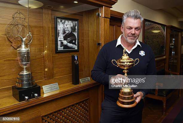 European Ryder Cup captain Darren Clarke poses with the trophy beside his own Open Championship trophy at Royal Portrush golf club as part of the...