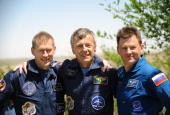 European Space Agency astronaut Frank De Winne of Belgium Canadian astronaut Robert Thirsk and Russian cosmonaut Roman Romanenko pose for the press...