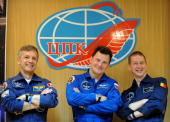 European Space Agency astronaut Frank De Winne of Belgium Canadian astronaut Robert Thirsk and Russian cosmonaut Roman Romanenko pose during a press...