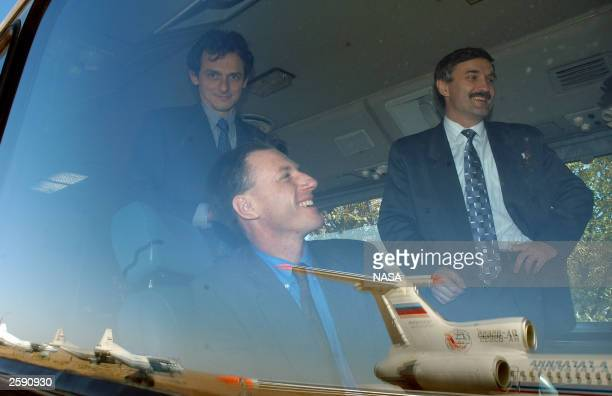 European Space Agency Astronaut Pedro Duque of Spain Expedition 8 Commander Michael Foale Expedition 8 Soyuz Commander and Flight Engineer Alexander...