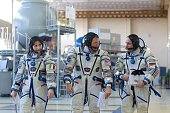 European Space Agency Italian astronaut Samantha Cristoforetti US astronaut Terry Virts and Russian cosmonaut Anton Shkaplerov walk during a...