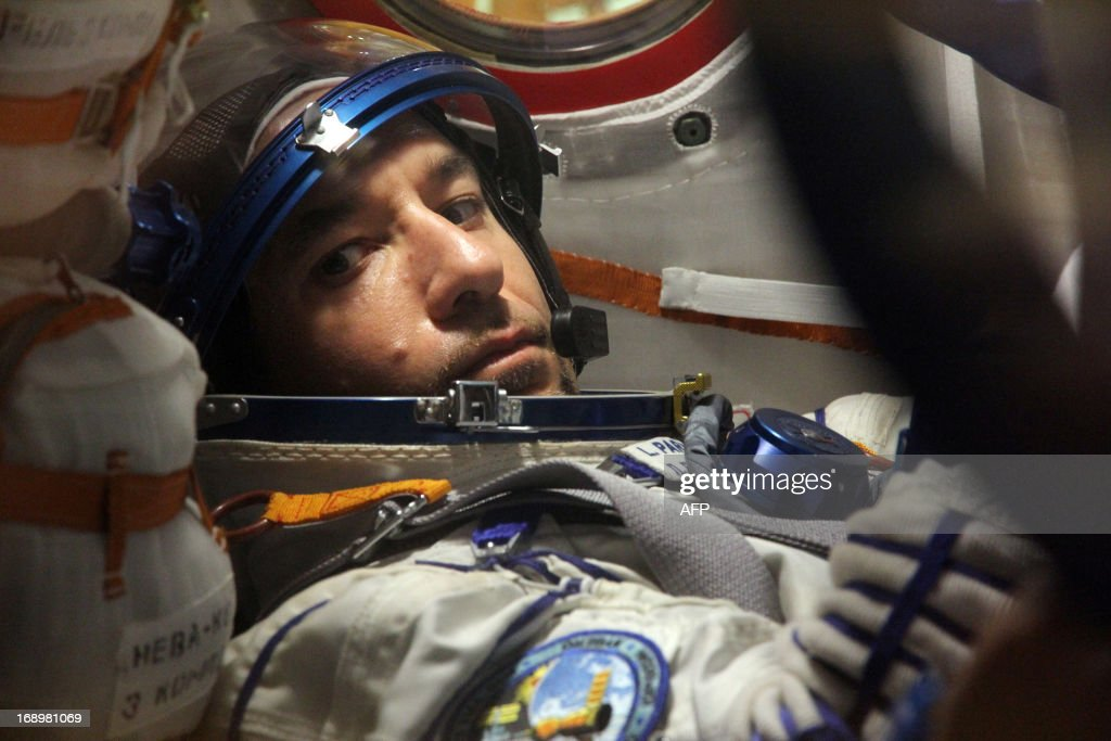 European Space Agency's (ESA) Italian astronaut Luca Parmitano is seen inside of the space capsule as he takes part in pre-flight training at the Russian-leased Baikonur cosmodrome on May 17, 2013. NASA's US astronaut Karen Nyberg, Russian cosmonaut Fyodor Yurchikhin and European Space Agency (ESA) Italian astronaut Luca Parmitano are scheduled to blast off to the International Space Station (ISS) from Kazakhstan's Baikonur cosmodrome on May 29.