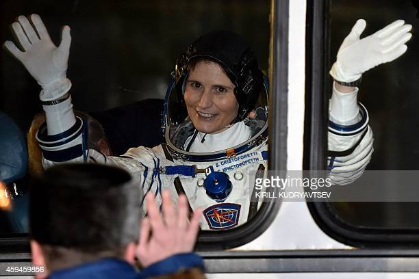 European Space Agency's Italian astronaut Samantha Cristoforetti waves from a bus after her space suit was tested at the Russianleased Baikonur...