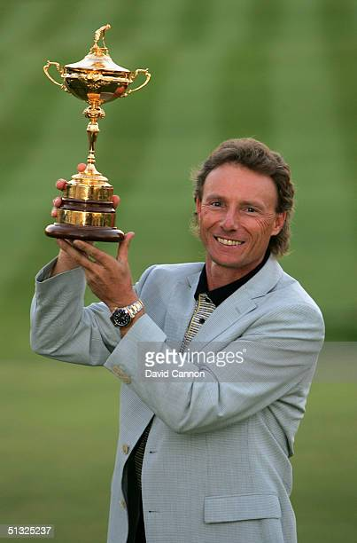 European team captain Bernhard Langer holds the trophy aloft after Europe's 18 1/2 to 9 1/2 victory at the 35th Ryder Cup Matches at the Oakland...