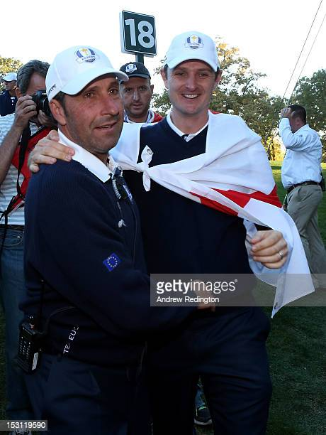 European team captain Jose Maria Olazabal and Justin Rose celebrate after Europe defeated the USA 145 to 135 to retain the Ryder Cup during the...