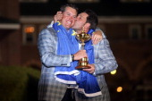 European team captain Jose Maria Olazabal kisses Lee Westwood after Europe defeated the USA 145 to 135 to retain the Ryder Cup during the Singles...